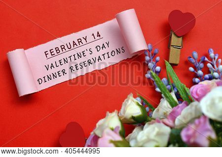 February 14 Valentine's Day Dinner Reservations Label On Torn Paper With Flowers And Heart Shape Clo