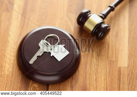 Judges Wooden Gavel And House Keys Lying On Table. Sale Of Real Estate At Auction Concept
