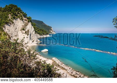 Beach Of Numana Alta, On The Italian Riviera With The White Cliffs And Clear Blue Water Of The Adria