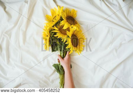 Candid Authentic Yellow Sunflowers Bouquet On Fabric White Background. Background With Bouquet Of Ye