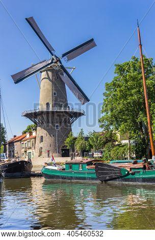 Gouda, Netherlands - May 21, 2020: Historic Windmill De Roode Leeuw In The Harbor Of Gouda, Netherla