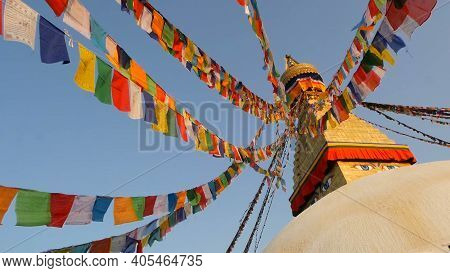 Colorful Prayer Flags Flying In The Wind At Boudhanath Stupa, Holy Pagoda, Symbol Of Nepal And Kathm