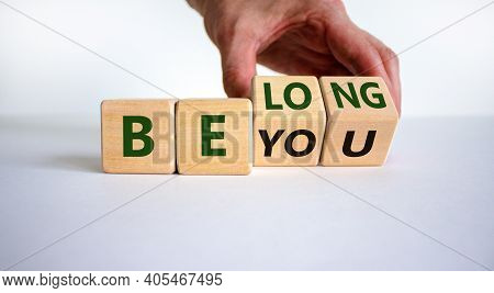 Be You, Belong Symbol. Businessman Hand Turns Cubes And Changes Words 'be You' To 'belong'. Beautifu