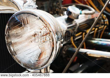 Round Headlight Of A Vintage Retro Car Close Up.