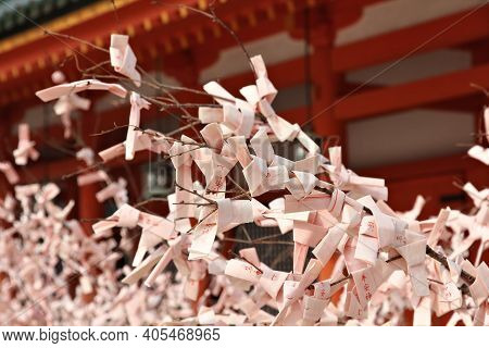 Kyoto, Japan - April 19, 2012: Omikuji Paper Fortunes Tied To A Tree At Heian Jingu Shrine In Kyoto,