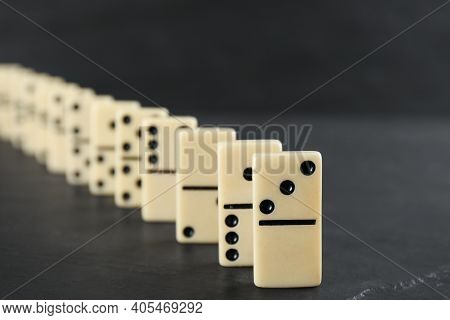 White Domino Tiles With Black Pips On Dark Grey Table