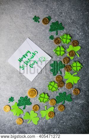 Decorative Clover Leaves, Green Gifts Box, Coins On Stone Background, Flat Lay. St. Patrick's Day Ce