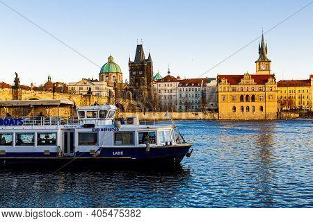 Prague, Czechia - 14 December 2017: Tourist Ship On The Vltava River On The Background Of Charles Br