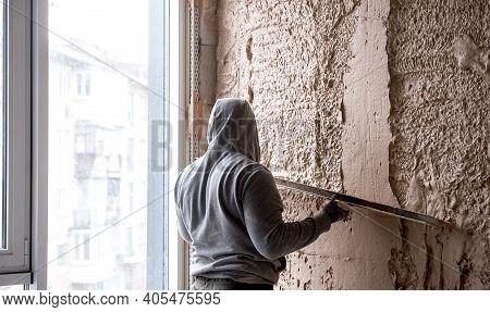 Machine Plaster. Walls With Gypsum Plaster Or Cement Plaster. Plasterer Operating Man Sprayer Equipm