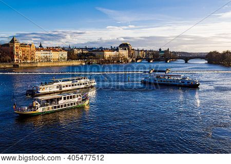 Prague, Czechia - 14 December 2017: Tourist Ships On The Vltava River.