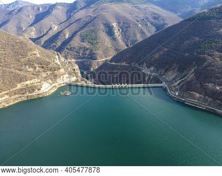 Aerial View Of Dam Of Vacha (antonivanovtsi) Reservoir, Rhodope Mountains, Plovdiv Region, Bulgaria