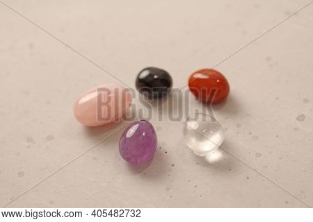 A Set Of Natural Stones Lies On A Light White Background, Garnet, Amethyst, Carnelian, Rock Crystal