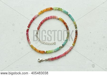 Short Necklace Made Of Rainbow Bright Multi-colored Tourmaline. Necklace Made Of Stones On Hand Natu