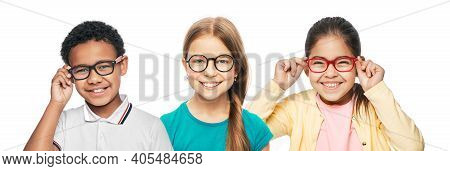 Group Of Smiling Multiethnic Kids Wearing Modern Eyeglasses On White Background. Childrens Vision Co