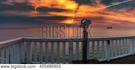 Lookout Point With Binoculars And View Of North Sea In Cuxhaven Town In Germany. In The Background A