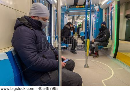Montreal, Ca - 24 January 2021: Passenger Sitting In Subway Train, Wearing Face Mask To Protect From
