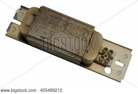 Burnt Out Electromagnetic Choke For Fluorescent Lamps On An Isolated White Background