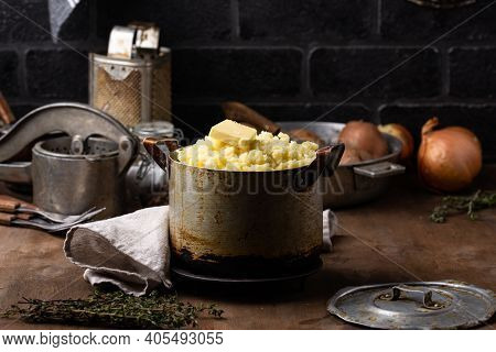 Mashed Potato In Old Vintage Pot. Rustic Kitchen Background