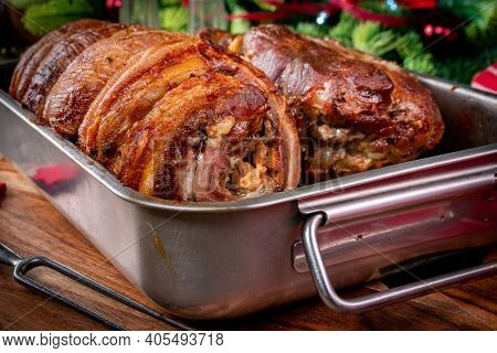 Baked Bacon Roulade And Roasted Pork Neck In A Metal Roasting Pan.