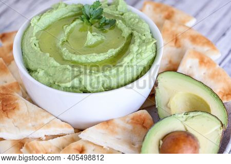Vegan Avocado Hummus, Made With Chickpeas, Avocados And Tahini, With Olive Oil. Garnished With Parsl