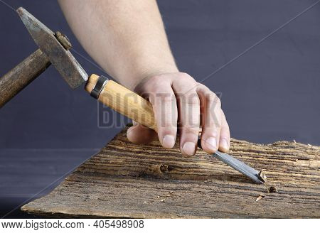 Work Of Carpenter. Handyman With Chisel And Hammer. Hand Holding Chisel. Woodworking And Craft Carpe