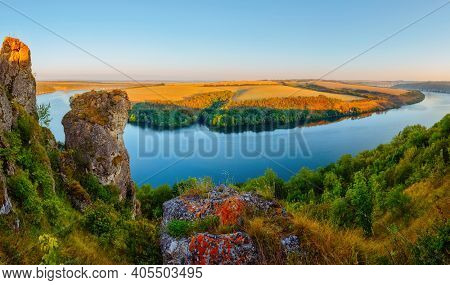 Panoramic view of meander of the Dniester River from a bird's eye view. Location place Dnister canyon of Ukraine, Europe. World landmarks. Picturesque photo wallpaper. Discover the beauty of earth.
