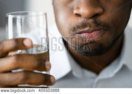 Water Mouth Gargle And Rinse. African American Man With Halitosis