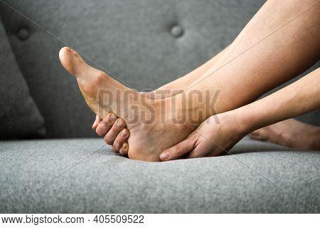 Woman Feeling Achilles Heel Pain In Bed