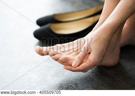 Uncomfortable Shoes Blister Pain. Woman With Sore Feet
