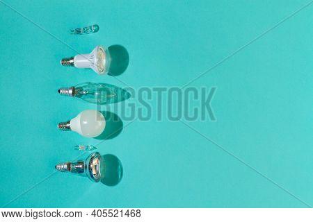 Different Light Bulbs: Halogen, Incandescent, Led, Fluorescent On A Blue Background.
