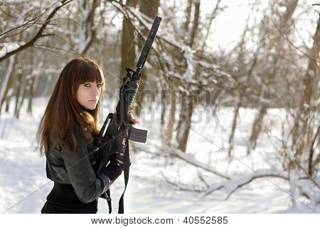Armed Woman In The Winter Forest
