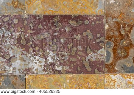 Corroded Rusty Background. Peeled Mottled Wall Streaked With Rust. Oxidized Abstract Spots On The Da