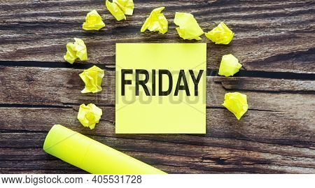 Notes About Friday ,concept On Yellow Stickers On Wooden Background