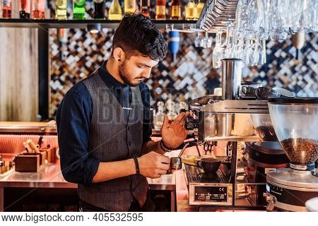Close-up Of Barista Making Espresso From A Coffee Machine In A Restaurant, Bar Or Pub. Professional