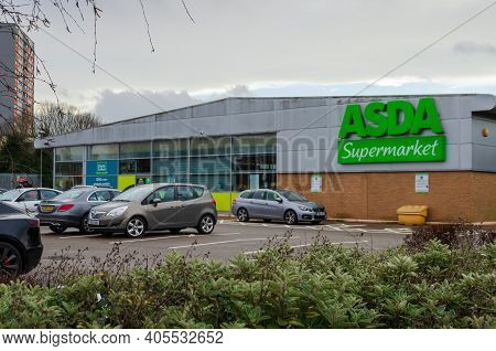 Flint; Uk: Jan 28, 2021: Cars Parked In Front Of Asda Supermarket In The North Wales Town Of Flint.
