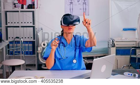 Healthcare Physician Experiencing Virtual Reality Using Vr Goggles In Hospital Clinic. Therapist Usi