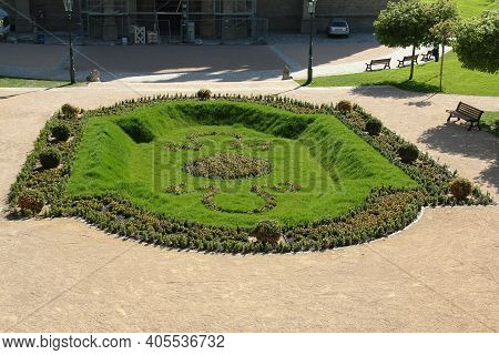 Kutna Hora, Czech - April 28, 2012: This Is A Well-groomed Flower Bed In The Public Garden In Front