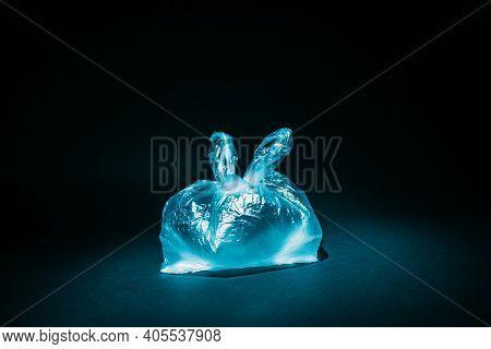 Ocean Pollution. Waste Contamination. Ecology Problem. Blue Wrinkled Used Cellophane Bag Underwater