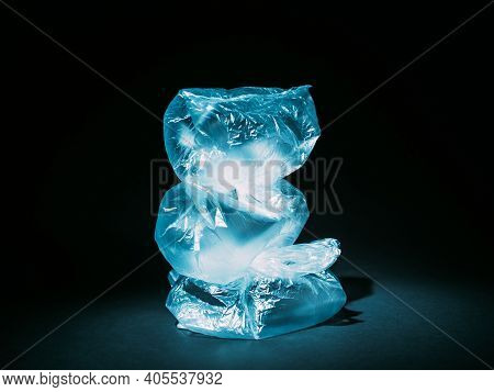 Pollution Art. Zero Waste. Garbage Management. Ecology Problem. Blue Wrinkled Used Cellophane Bags S