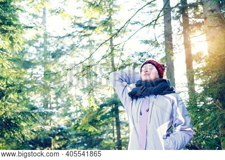 Woman Breathing Fresh Air In The Forest. Woman Spreading Her Arms In The Forest Back View: Balance,