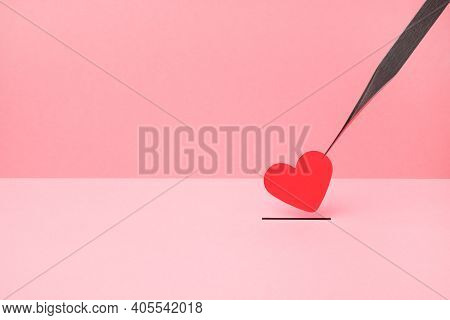 A Small Red Heart Made Of Paper Is Held With Tweezers And Put In The Slot. Valentines Day, Happy Lov