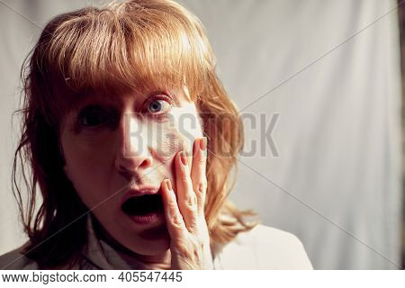 Portrait Of Perplexed Puzzled Middle-aged Woman On A White Background. Unprofessional Female Model P