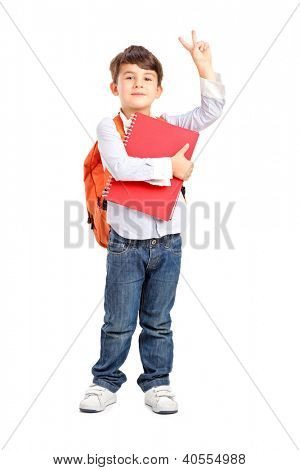 Full length portrait of a school boy holding a notebook and gesturing isolated on white background