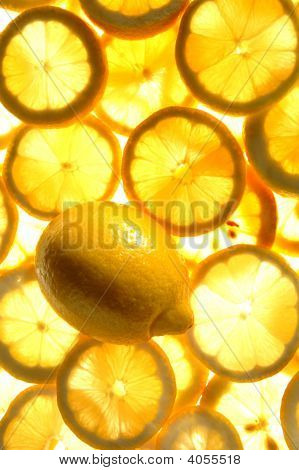 Lemon With A Background Of Lemon Slices