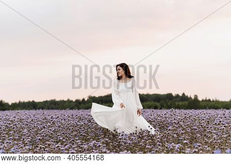 Provence Blooming Field. The Girl Is Happy And Laughs Running Through The Blooming Field.