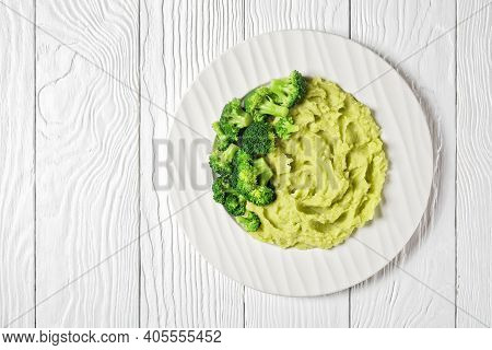 Broccoli Potato Mash Served With Broccoli Florets On A Plate On A White Wooden Table, Horizontal Vie