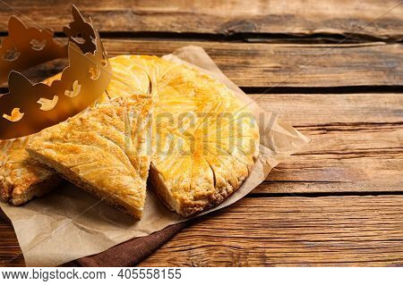 Traditional Galette Des Rois With Paper Crown On Wooden Table