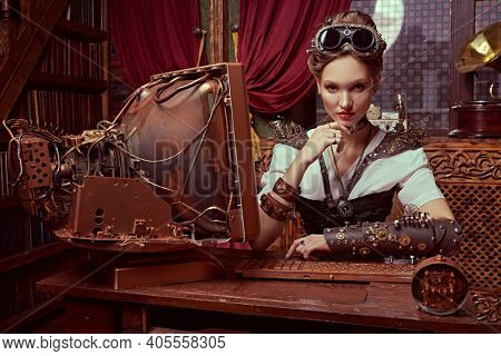 Beautiful steampunk lady scientist inventor works in her laboratory with Victorian interior.