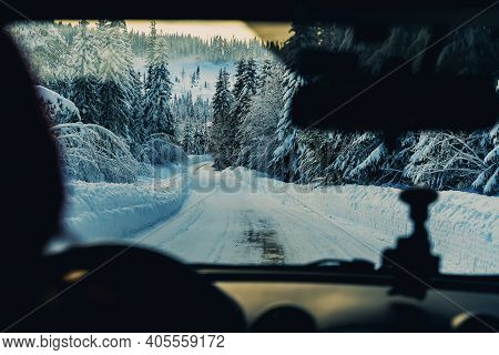 Diving On A Snowy Road Through A Winter Wonderland. Drivers Point Of View.