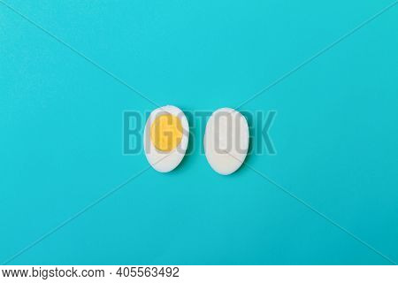 The Egg Is Cut Into Two Halves. There Is No Yolk In One Half Of The Egg.